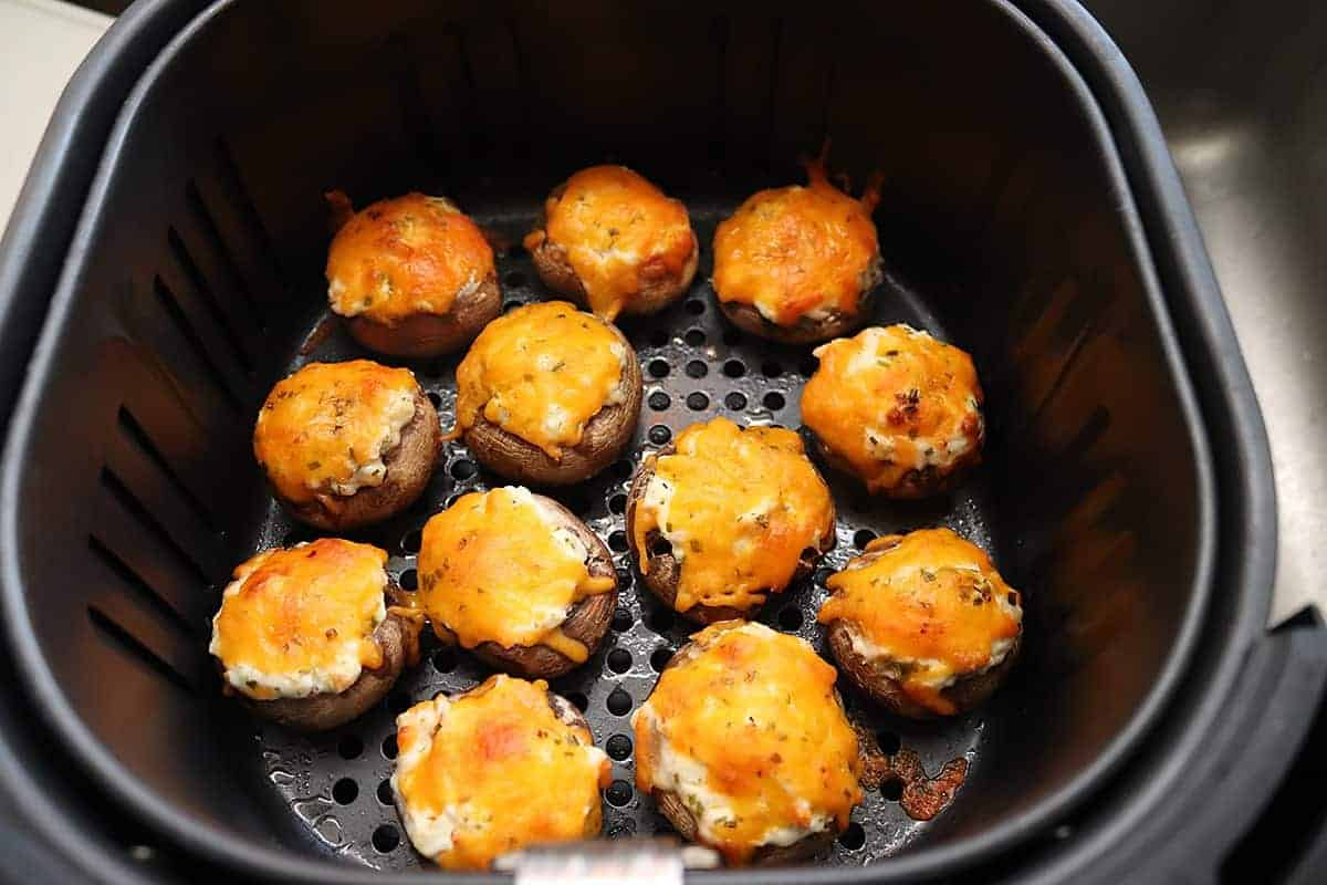 Air fryer basket with cooked mushrooms